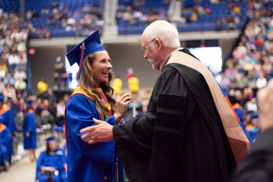 Jonathan E. Martin presented Shelby Bergeron and all other grads a Native American gold dollar coin.