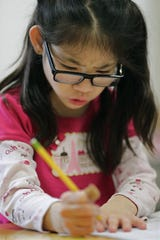 Amelia Peche works on her math skills during an intellectual disabilities cross categorical special education class at Huntley Elementary School in Appleton.