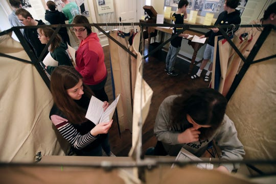 "Neenah High School juniors Allison Waldhart and Michelle Millem participate in a mock vote in the 1920 presidential election at the ""Voting for a Change: Impact of the 19th Amendment on our Community"" exhibit at the Neenah Historical Museum."