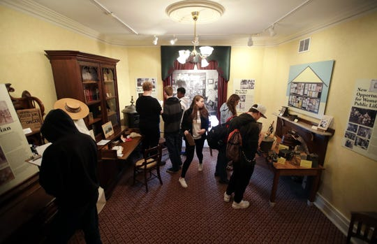 "Students from Neenah High School's U.S. History course take an early browse through the ""Voting for a Change: Impact of the 19th Amendment on our Community"" exhibit at the Neenah Historical Museum which will open to the public on May 19th."