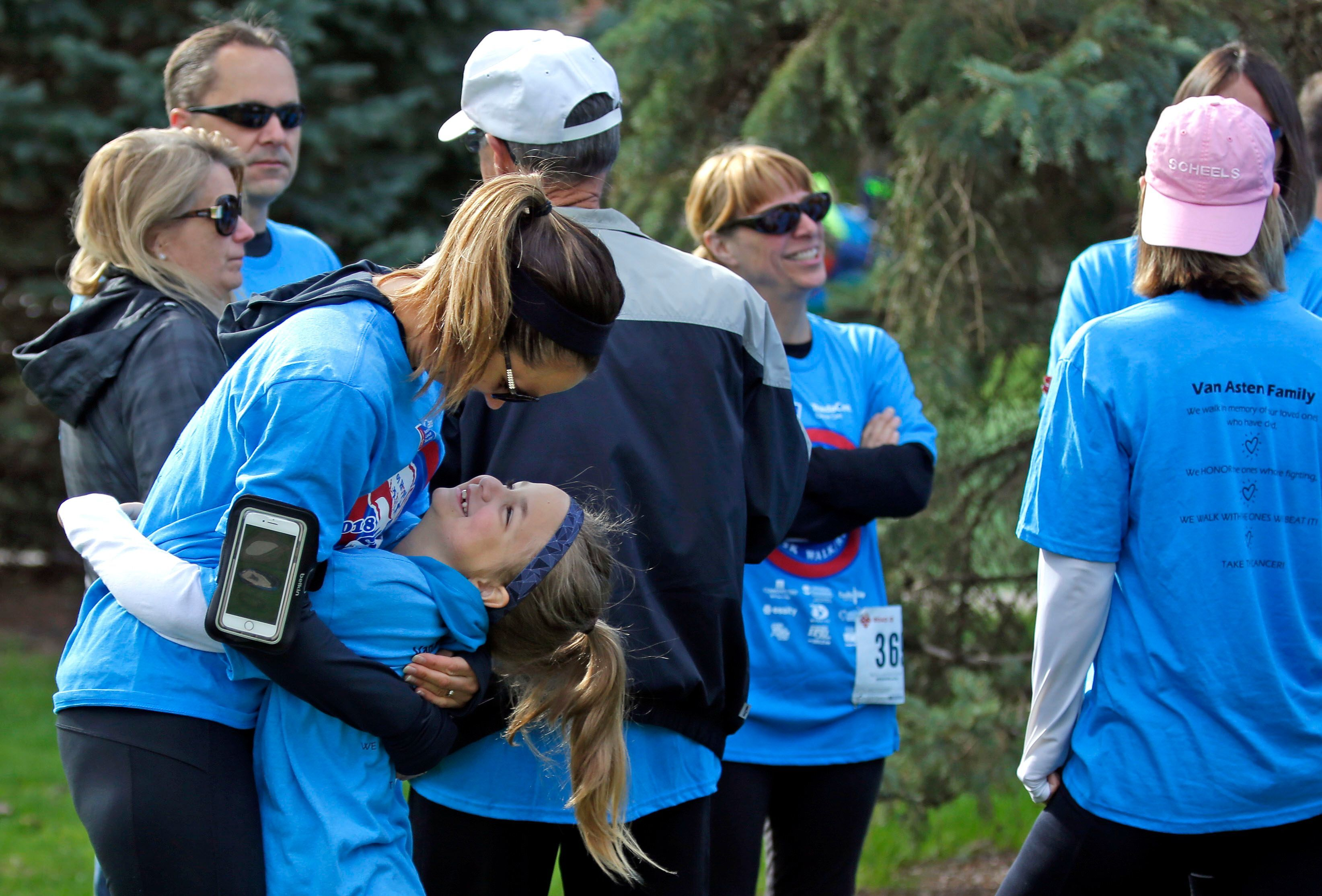 Karen Dietzler gets a hug from her daughter, Chloe, before the 2018 Sole Burner Run/Walk at City Park in Appleton.