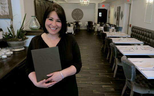 Patty Caneda is shown inside one of the dining rooms at Caneda's White Rooster, a year-old Toms River-based Cuban restaurant on Fischer Boulevard.