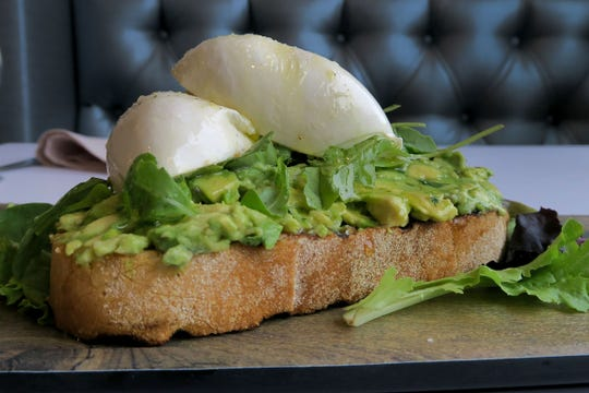 The Avocado Toast w/ Burrata from the lunch menu at Caneda's White Rooster, a year-old Toms River-based Cuban restaurant on Fischer Boulevard.  It features fresh avocado spread over buttered charred sourdough bread topped with burrata, honey and arugula.
