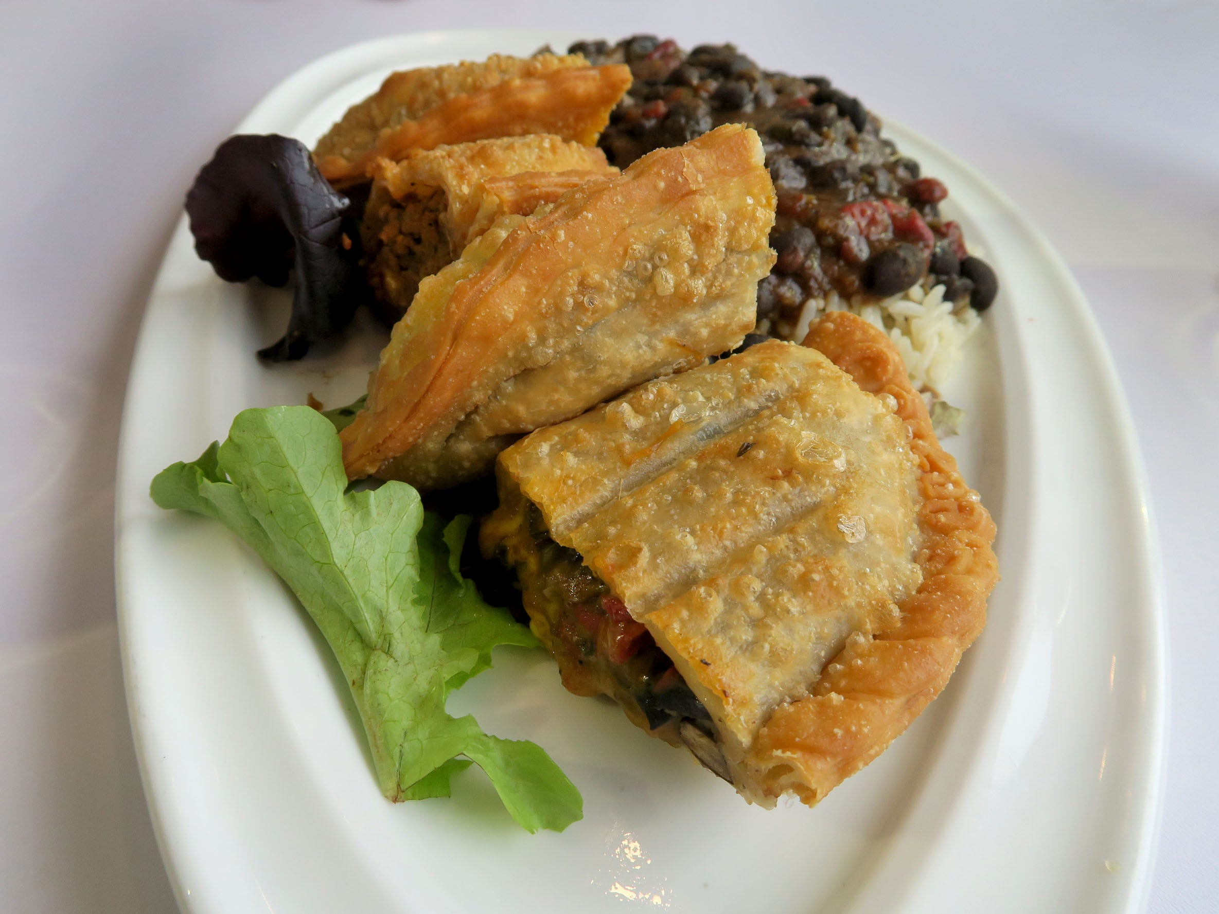 The Empanada Combo served with a side of black beans and white rice at Caneda's White Rooster, a year-old Toms River-based Cuban restaurant on Fischer Boulevard.