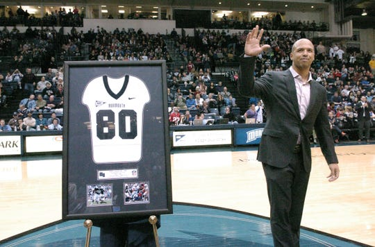 Monmouth University alum and Dallas Cowboy's wide receiver, Miles Austin, waves to the crowd during a ceremony retireing his number at the MAC in West Long Branch on Sat evening. Frank Galipo/Special to the Press ASB 0223 Monmouth BB I