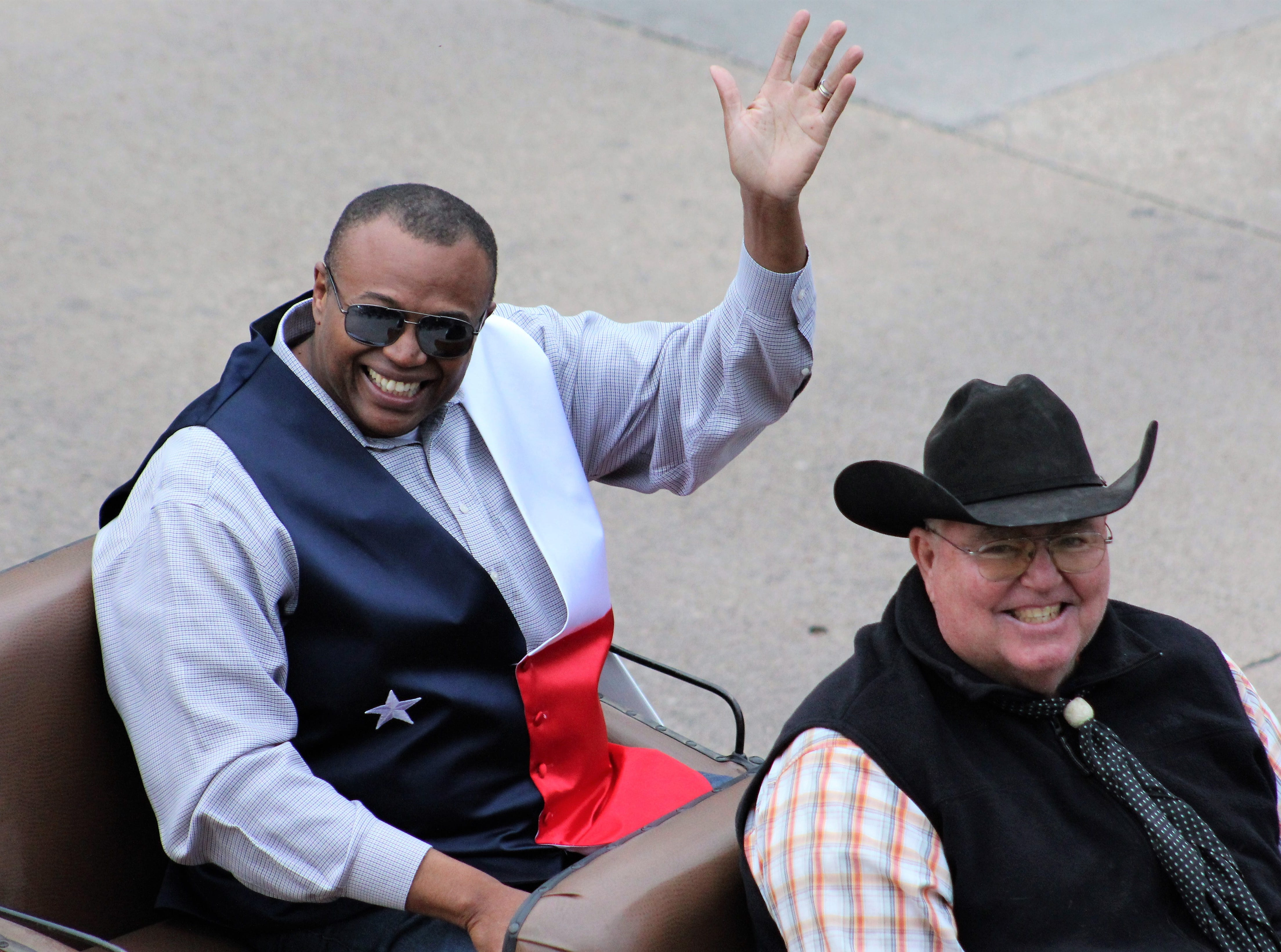 """Abilene Mayor Anthony """"Tex"""" Williams waves his howdys to parade-watchers hollering at him during Thursday evening's Western Heritage Classic parade through downtown Abilene. May 9, 2019"""