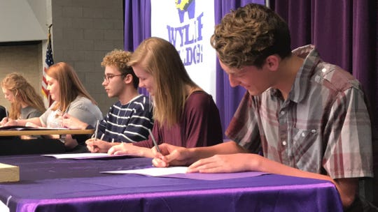 Seven Wylie High School seniors signed letters of intent to study fine arts or participate in music programs at college next year during a signing ceremony at the Wylie High School Performing Arts Center on Friday. Included in the ceremony were, from left, Hardin-Simmons University commits Kathlyn Messer McKenna Jones, Texas State University-bound Blake Wadley,  and Texas A&M University commits Allyson Steadman and Declan Sauley.