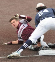 Midland Greenwood third baseman Jalen Fuentes tags out Brownwood's Reece Rodgers, who was trying to stretch a double into a triple in the third inning in Game 2 of their Region I-4A area playoff series Friday at ACU's Crutcher Scott Field.