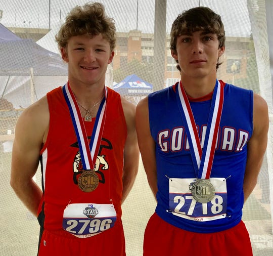Gorman's Jr. Madera, right, won silver in the Class 1A boys long jump at the UIL state track and field meet Friday in Austin. Ira's Karson Valentine finished third.