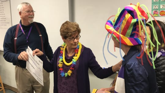 Wylie High School Spanish teacher Bill Young accepts a big check for $901 from Becky Rentz, center, and others from the Wylie Bulldogs Education Foundation Friday. The foundation awarded 29 grants this past week totaling more than $31,000.