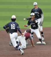 Brownwood runner Hunter Leonard dives back into second base as Midland Greenwood's Jalen Fuentes (24) fields the throw from Skyler Dominguez during a rundown in the third inning. Leonard, who was safe on the play, had started to steal third, held up and then got caught in the rundown. He was left stranded on the play in Game 2 of their Region I-4A area playoff series Friday.