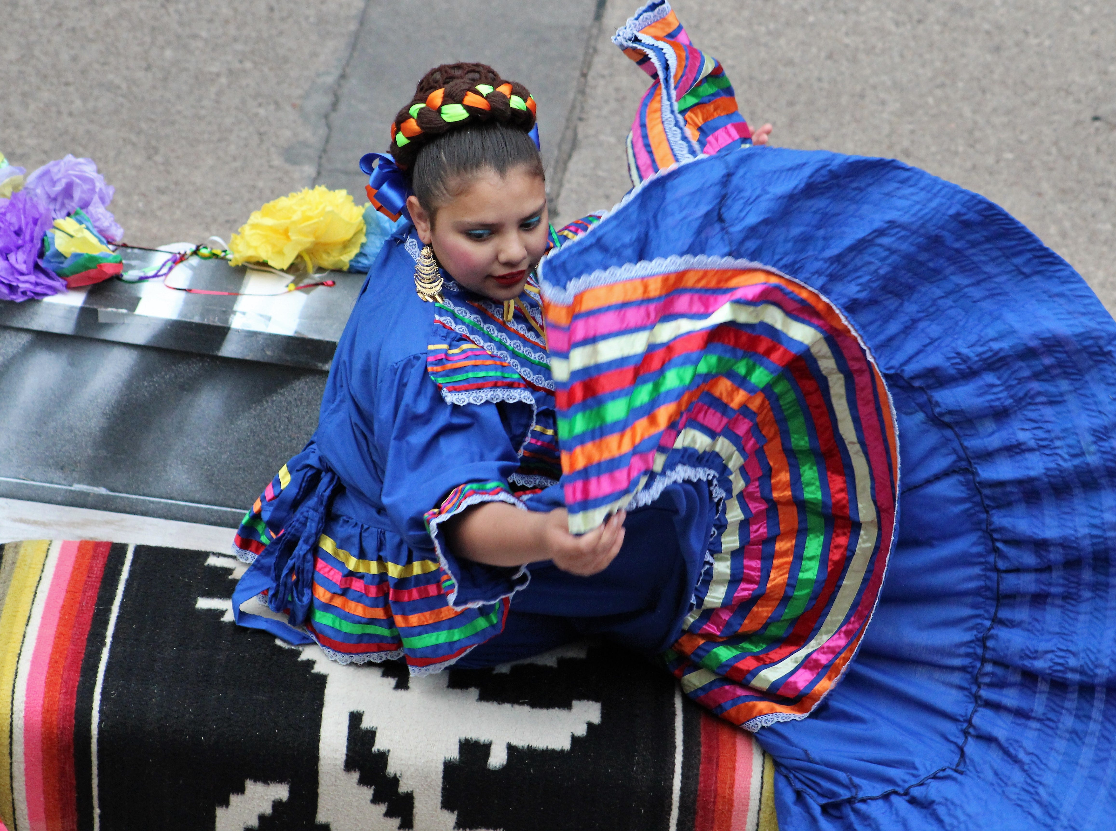 A folklorico dancer twirls her colorful dress on a float in Thursday evening's Western Heritage Classic parade in downtown Abilene. May 9, 2019