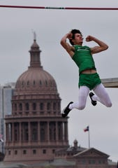 Braden Campbell celebrates clearing the bar in the Boys 3A pole vault during during the UIL State Track & Field Championships in Austin on Friday.