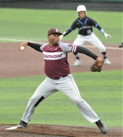 Brownwood pitcher Gavon Clemons throws a pitch in the first inning while Midland Greenwood runner Skyler Dominiguez leads off first base during Game 2 of their Region I-4A area playoff series Friday at ACU's Crutcher Scott Field.