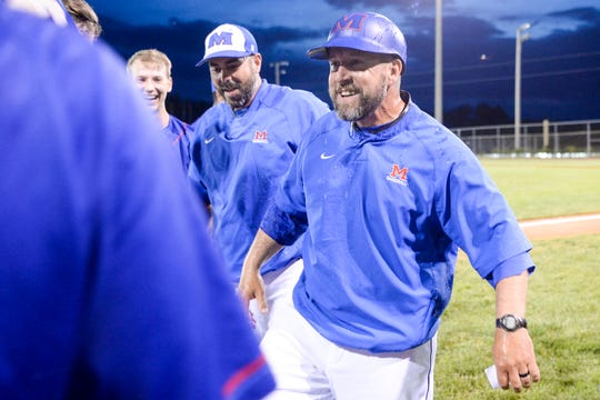 Madison Head Baseball Coach Ronald Tipton celebrates the 2019 team's landmark second round playoff win over West Stanly.