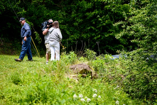 "Cheryl and Scott Fowler talk to media at the top of a steep ravine near their home in Hendersonville May 10, 2019, where they found 7-week-old Shaylie Madden bruised and crying May 9. The couple, with the help of their daughter, rescued the child, who was wearing a pink onesie that read, ""I love my mommy."" The mother of the child, Krista Madden, 35, has been charged with attempted first-degree murder after faking the kidnapping of the infant and throwing her down the steep ravine."