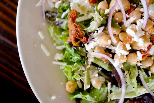 The Mediterranean Salad at Blue Mountain Pizza and Brew Pub is made with spring mix, feta, kalamata olives, shaved red onion, garbanzo beans, sun-dried tomatoes, basil and dressed with a honey lime vinaigrette.