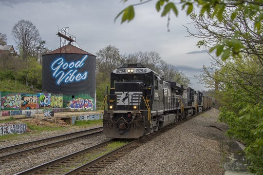 A freight train makes it way through Asheville's River Arts District in this file photo. Coal deliveries to Duke Energy's Lake Julian electric plant will stop once the new gas-fired plant opens later this year.