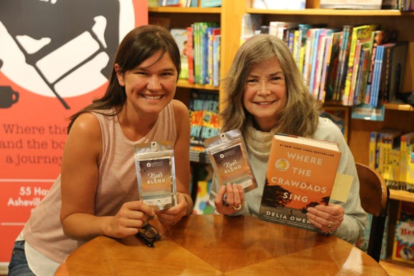 Jessie Dean, left, owner of Asheville Tea Co., meets author Delia Owens May 8 at Malaprop's Bookstore. The two teamed up with Owens' publisher, Putnam's Sons, to create a limited run tea called Kya's blend, in honor of the book's heroine.