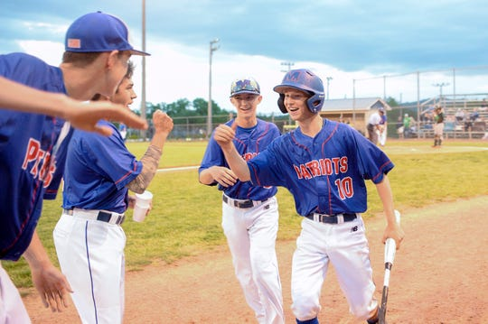 Daniel Hensley bumps fists with teammates after scoring in the Patriots second round playoff win over West Stanly in 2019. Hensley was one of 13 players to miss out on his senior season due to the coronavirus.