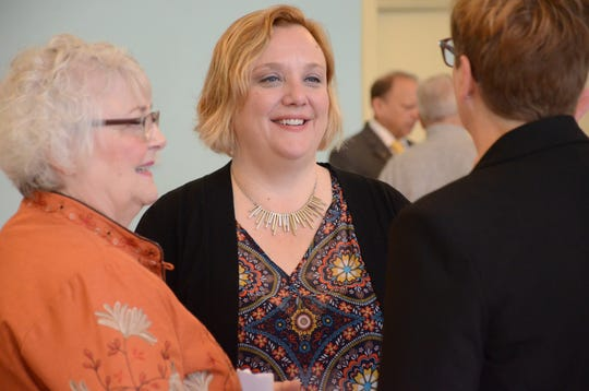 Jennifer Conley Darling greets some of the guests Friday.