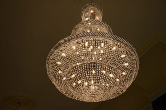Four, 500-pound chandeliers were assembled and hoisted to the ballroom ceiling.