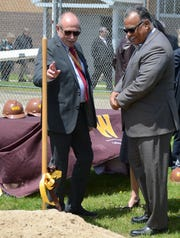 College of Aviation dean Dave Powell, left, and WMU President Edward Montgomery prepare to turn some ceremonial soil on Friday.
