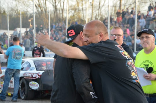 Galesburg Speedway manager Ed Santora hugs his cousin and driver AJ Foote before the Todd Foote Victory 100 at Galesburg Speedway on May 4, 2019.