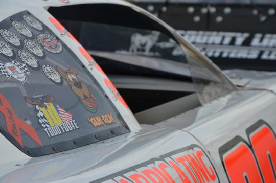 A sticker in memory of Todd Foote sits on the window of the No. 88 Late Model Stocks car, driven by his brother, AJ Foote.