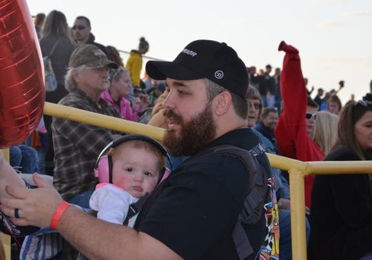 KC Biron, with his 8-month-old daughter, Ryleigh, prepares to wave the white flag of the Todd Foote Victory 100 at Galesburg Speedway on May 4, 2019. The race is in honor of his late father, who died of cancer in 2017.