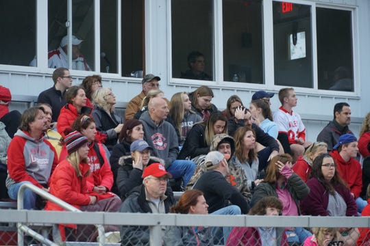 Fans take in Thursday night's boys lacrosse game between Chenango Forks and host Chenango Valley. The Blue Devils won, 12-7.
