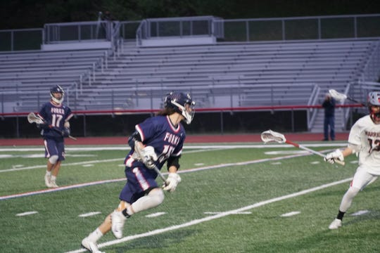 Chenango Forks' Troy Arno possesses the ball during the first quarter of Thursday's game at Chenango Forks. Arno scored one goal in the Blue Devils' 12-7 victory.