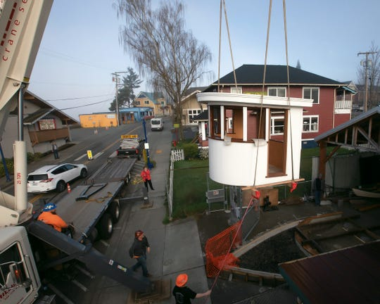 Crews lift the finished Hyak pilot house into place at the Poulsbo Maritime Museum.