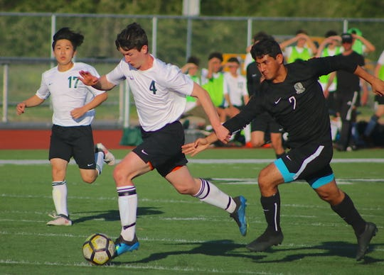 Klahowya's Kris Chaparro (right) tries to chase down Vashon Island's Tommy Delargy during Thursday's playoff game at Orting High School.