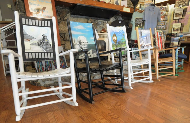 A collection of rocking chairs from past Little Town That Rocks campaigns are displayed prominently in the Black Mountain-Swannanoa Chamber of Commerce visitor center. The organization is still looking for sponsors and photograph submissions for this year's fundraiser.
