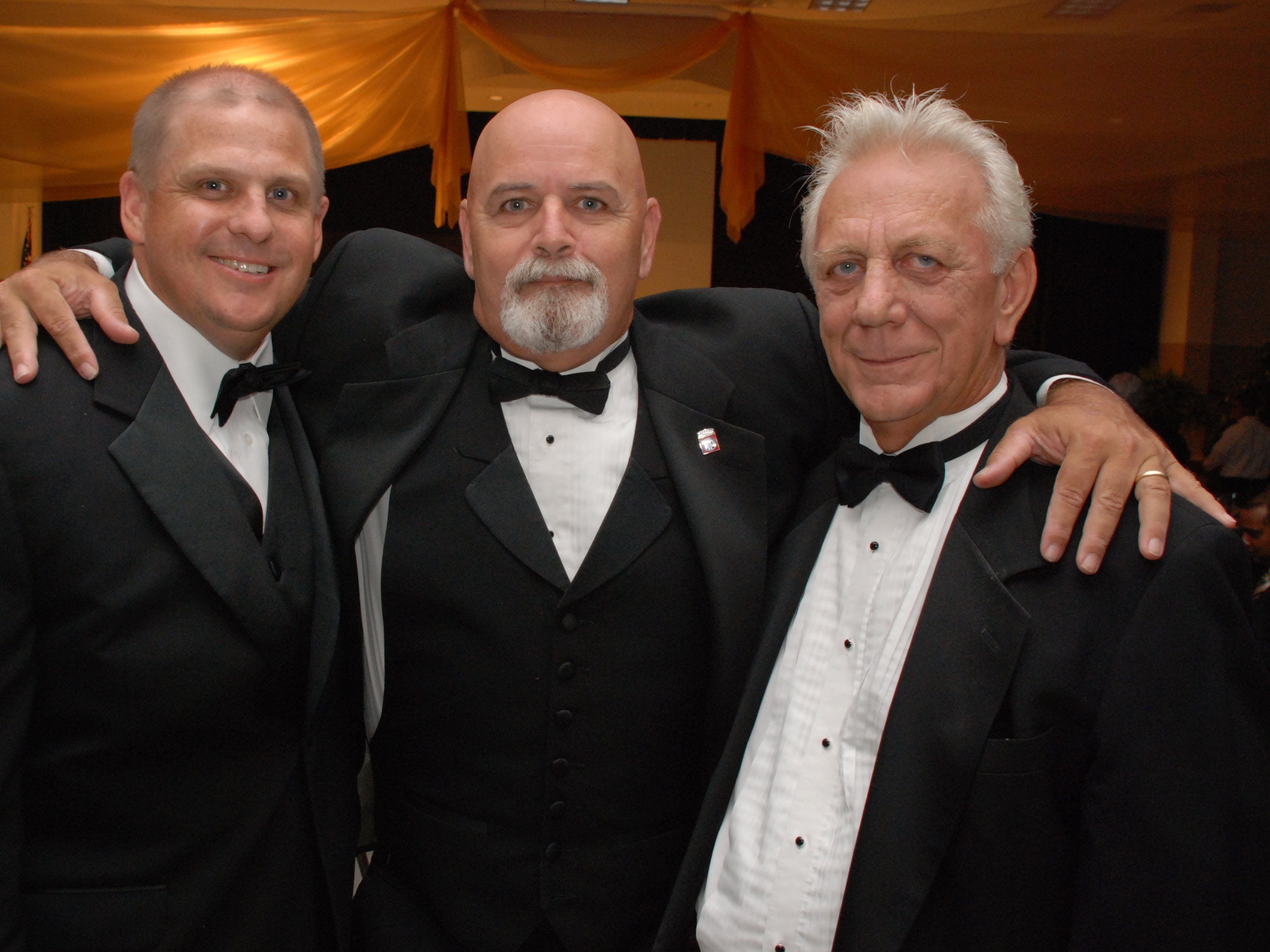 In this 2010 file photo, State Rep. Ritch Workman, Dave Isnardi and Mayor John Mazziotti had some laughs at the Palm Bay Mayor's Ball.