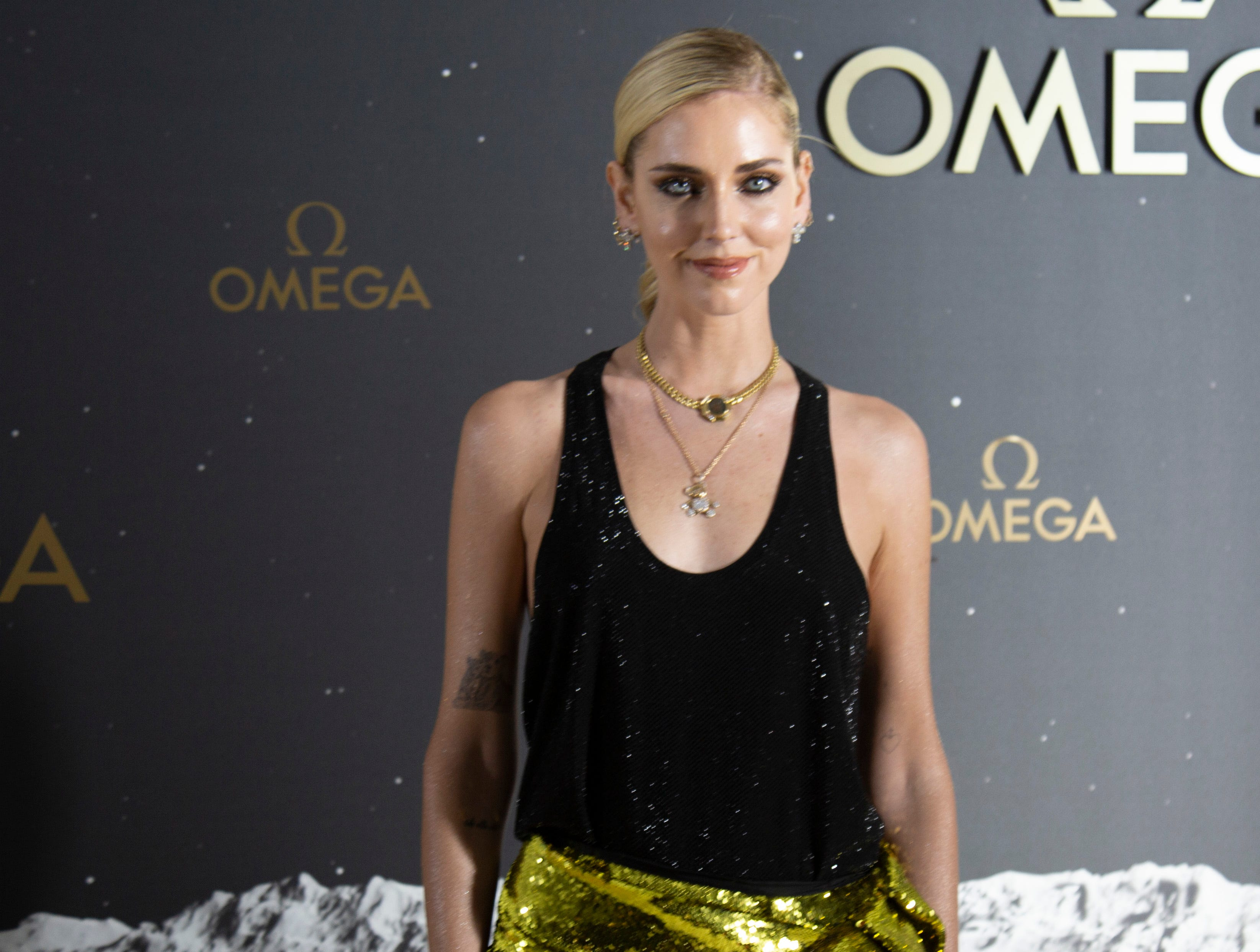 Model and social media influencer Chiara Ferragni. The Swiss watch brand Omega, which accompanied Apollo 11 astronaut Buzz Aldrin when he walked on the moon's surface nearly 50 years ago, hosted an event honoring the 50th anniversary of the moon landing at the Apollo/Saturn V Center at Kennedy Space Center. Those who attended the black-tie dinner included actor George Clooney and Amal Clooney, as well as former astronauts Thomas Stafford and Charles Moss Duke.