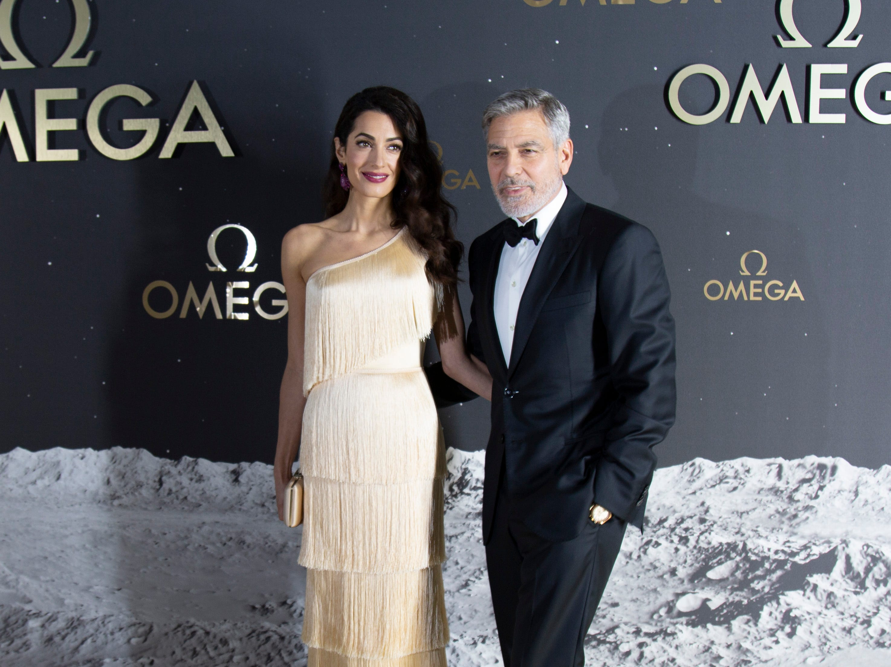 George and Amal Clooney at the red carpet outside the Apollo/Saturn V Center Thursday evening. The Swiss watch brand Omega, which accompanied Apollo 11 astronaut Buzz Aldrin when he walked on the moon's surface nearly 50 years ago, hosted an event honoring the 50th anniversary of the moon landing at the Apollo/Saturn V Center at the Kennedy Space Center. Those who attended the black-tie dinner included actor George Clooney,  as well as former astronauts Thomas Stafford and Charles Moss Duke.