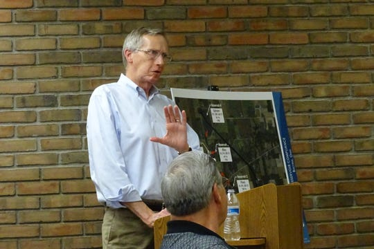 Bruce Brandstetter, of Brandstetter Carroll, speaks to Bucyrus City Council members about the future of the city's reservoirs during committee meetings Thursday night.