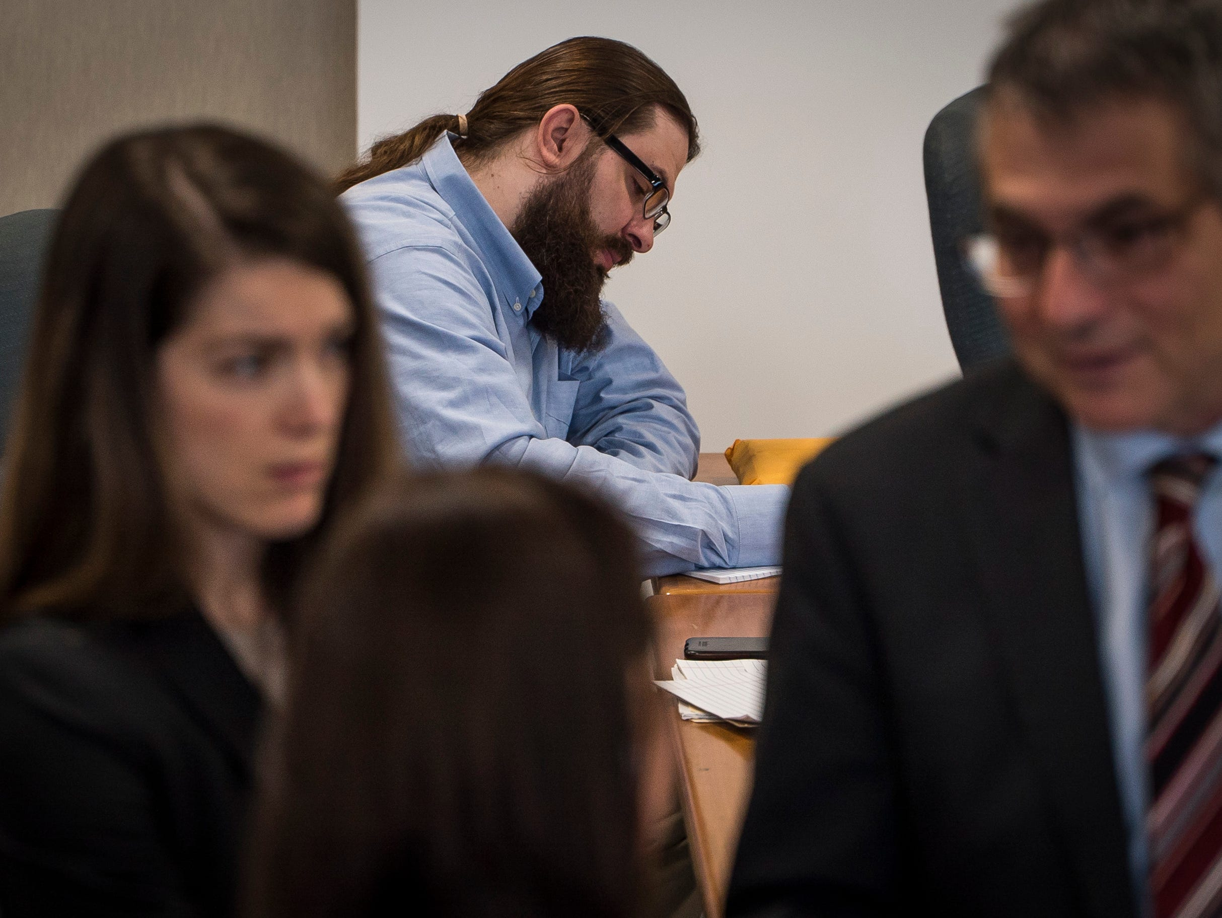 Steven Bourgoin takes notes in Vermont Superior Court in Burlington on Friday, May 10, 2019, during his trial. He faces second-degree murder charges in the deaths of 5 teens killed in a crash on I89 in 2016.