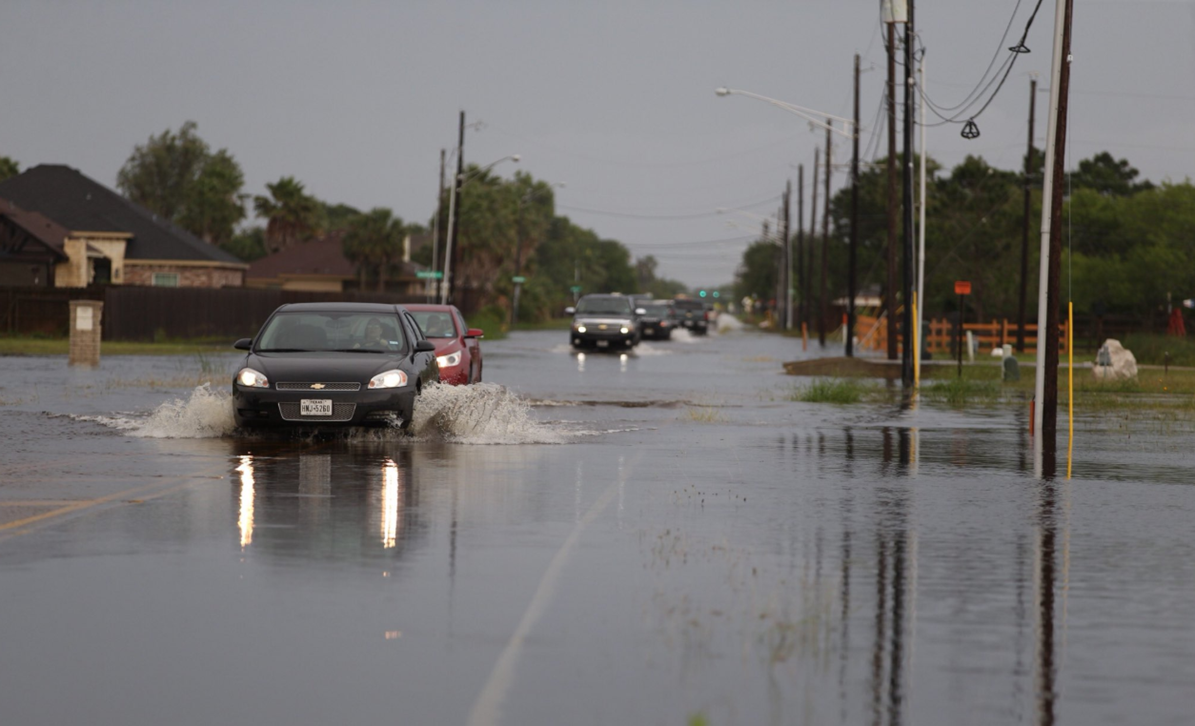 Motorists splash through Glenoak Drive their morning commute Friday, just minutes after a series of strong thunderstorms hit the Corpus Christi area.