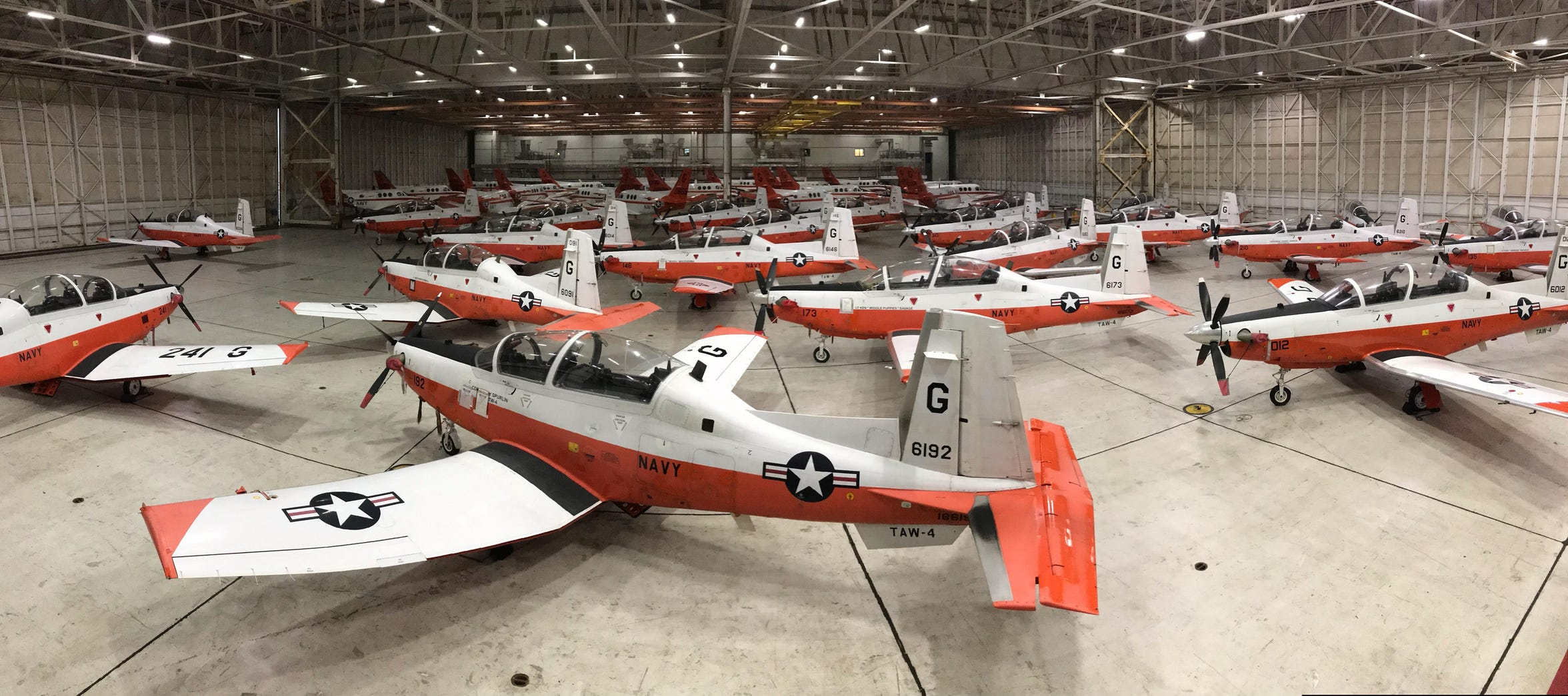 Training Air Wing 4's fleet of T-6B Texan II and T-44C Pegasus aircraft are carefully packed into a hangar to protect them from severe weather at Naval Air Station Corpus Christi, Texas, May 10. A crew worked through the night to ensure the aircraft were properly secured ahead of the storm. Training Air Wing 4 trains the world's premier military pilots in the primary, intermediate, and advanced phases of multi-engine aircraft training. (U.S. Navy photo by Lt. Michelle Tucker/Released)
