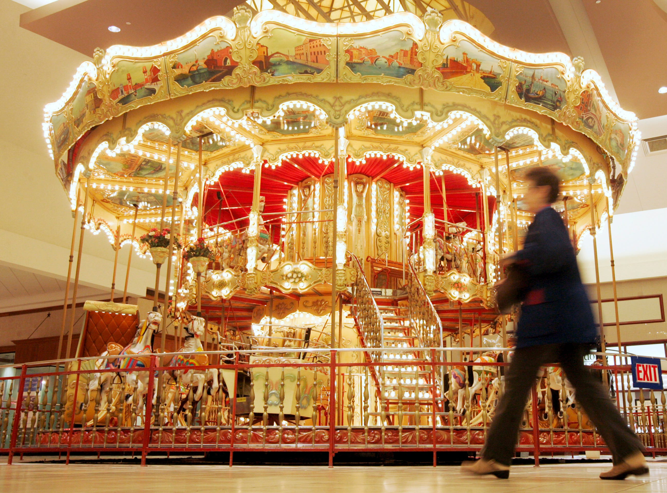 Mall patrons walk past the 25-foot tall carousel Wednesday, Jan. 14, 2009 located inside of La Palmera in Corpus Christi. Mall officials said the owners have until Jan. 31 to be out of the mall to make way for renovations and updates to the facility.