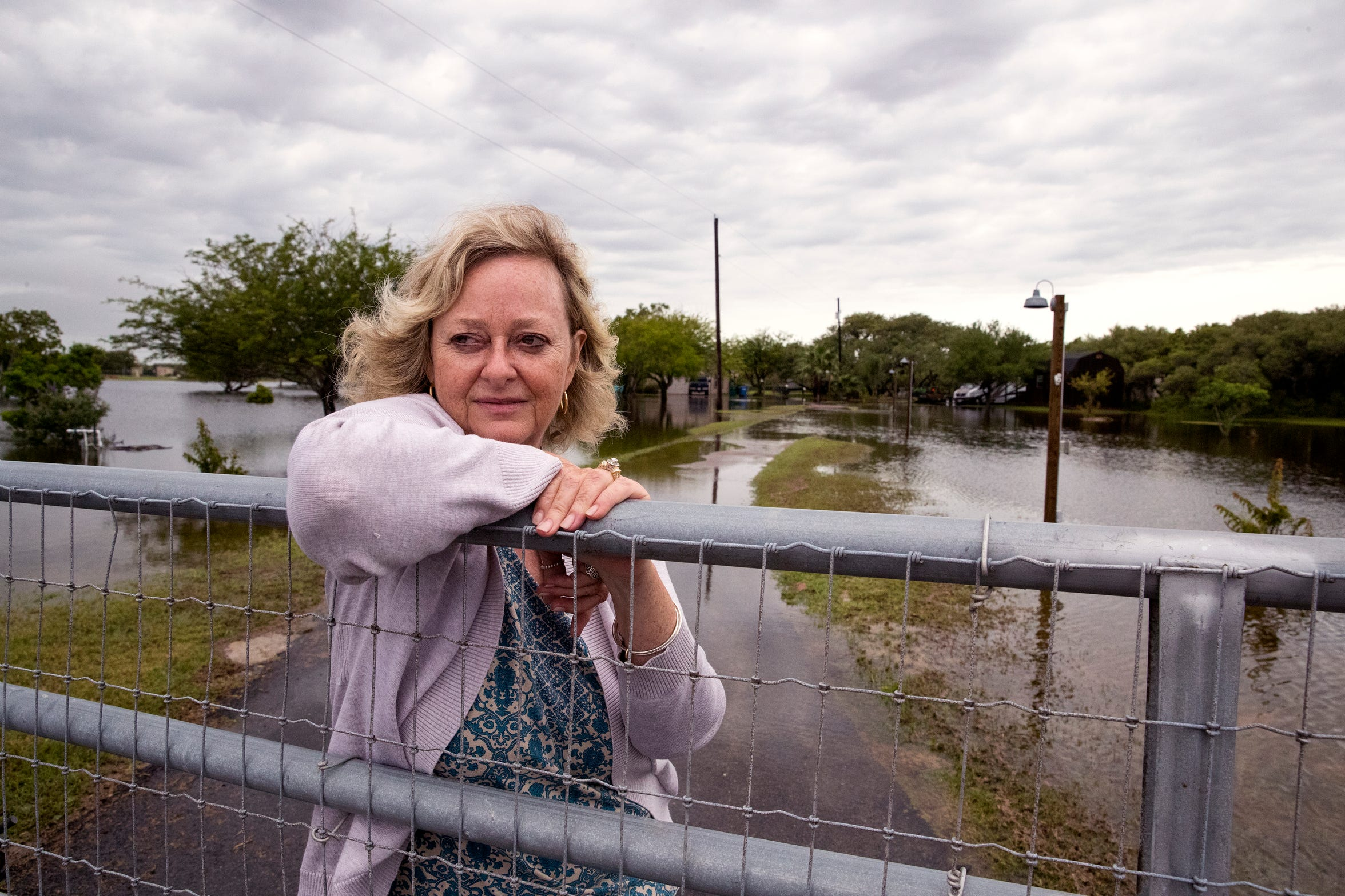 While water hasn't yet entered her home, Lynn Withers has water on every side of her yard at her home on Flour Bluff Drive following heavy rains on Friday, May 10, 2019. She said the city needs to make sure drainage ditches are cleaned out and long-term needs to improve the infrastructure.