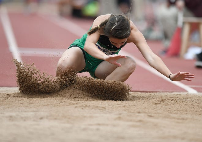 Blackwell's Kiley Cummings falls into the sand pit during her triple jump at the UIL State Track and Field meet, Friday, May 10, 2019, in Austin.