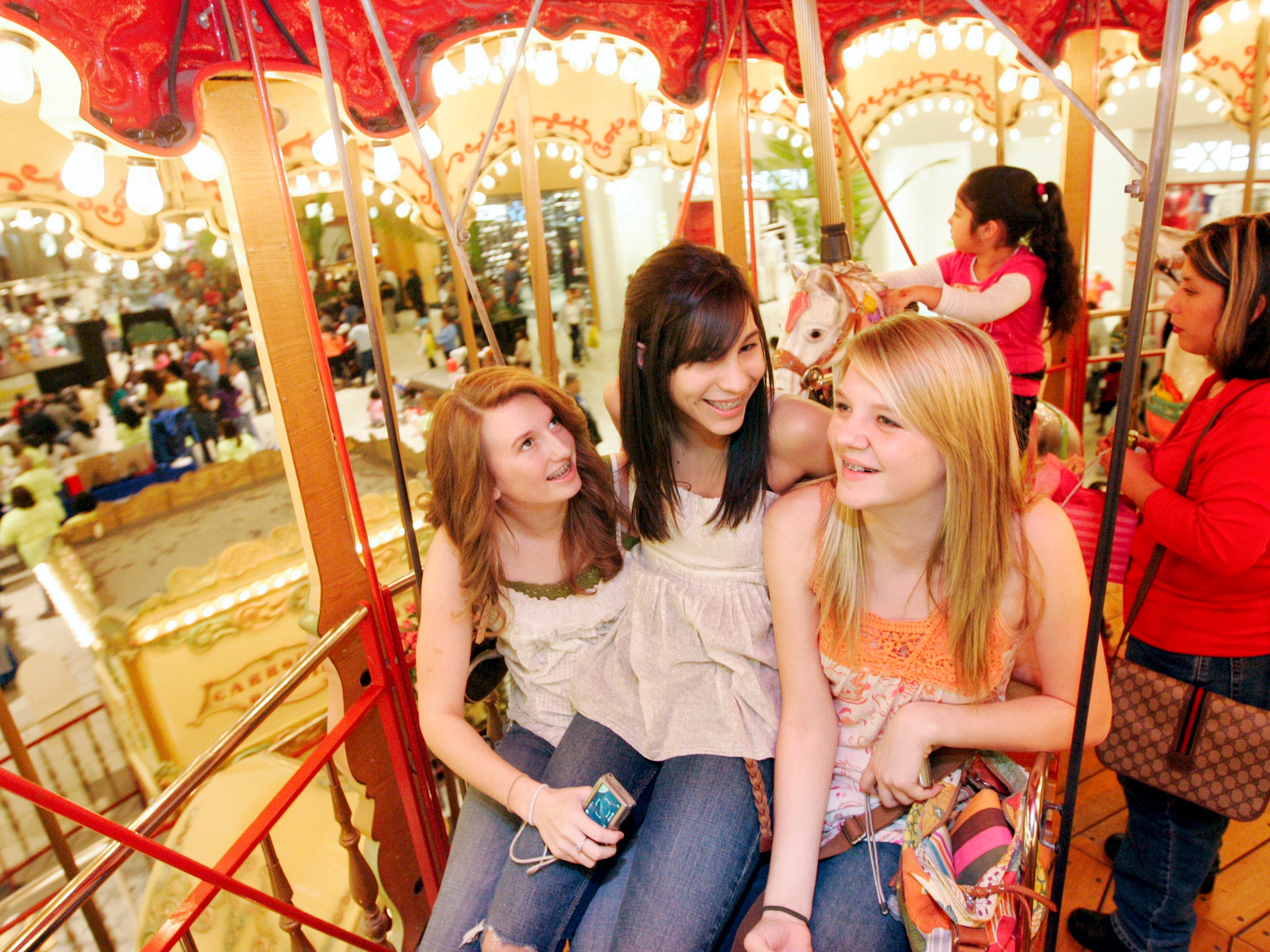 Haven Gibbs (from left), Brianna Gomez, and Allie Kubacak, all 14, sit on a seat together on the second level of the carousel Saturday, Jan. 31, 2009 at La Palmera mall in Corpus Christi. The three girls, all from Brady, Texas, were in town for Gomez' birthday and visiting Gomez's grandparents in Port Aransas.