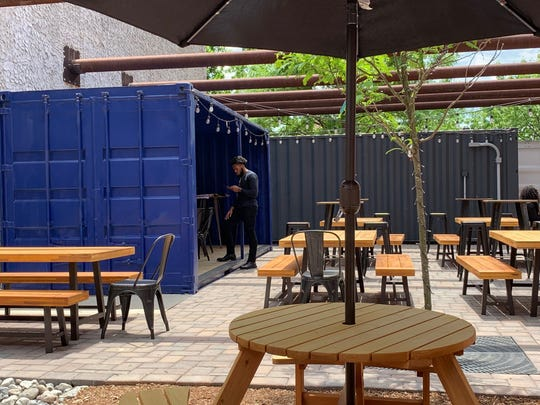 Shipping containers provide seating, a commissary kitchen and the stage area for the new Camden Arts Yard on Market Street.