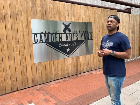 Damon Pennington gets ready to open the doors to Camden Arts Yard in Camden. The seasonal beer garden is ready to greet customers on Market Street with food, a bar, live entertainment and art installations and experiences.