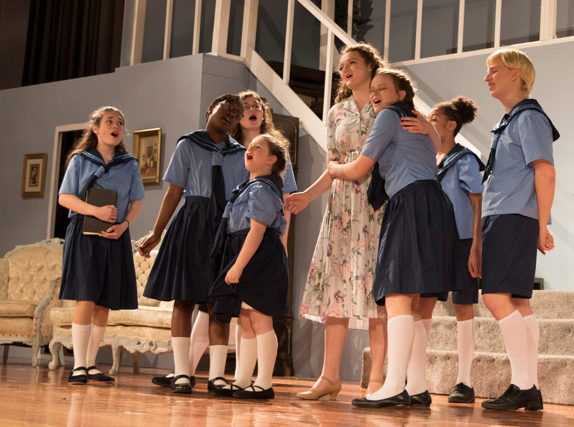 The von Trapp children excitedly welcome their governess Maria Rainer, played by Emily Schafer, back after she had left for a time to decide whether she should take her monastic vow or follow her heart and be with Captain von Trapp.