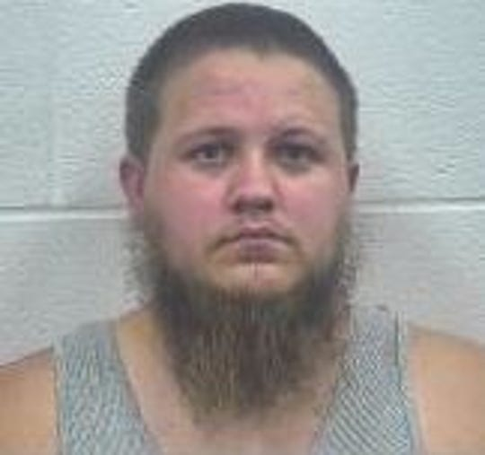 Covington police say they found Tyler Gregg in a vehicle with a gun on the dashboard in the parking lot of an elementary school Friday.